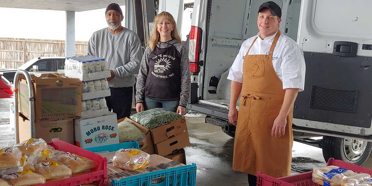 Southland Casino team members organizing food for community donation